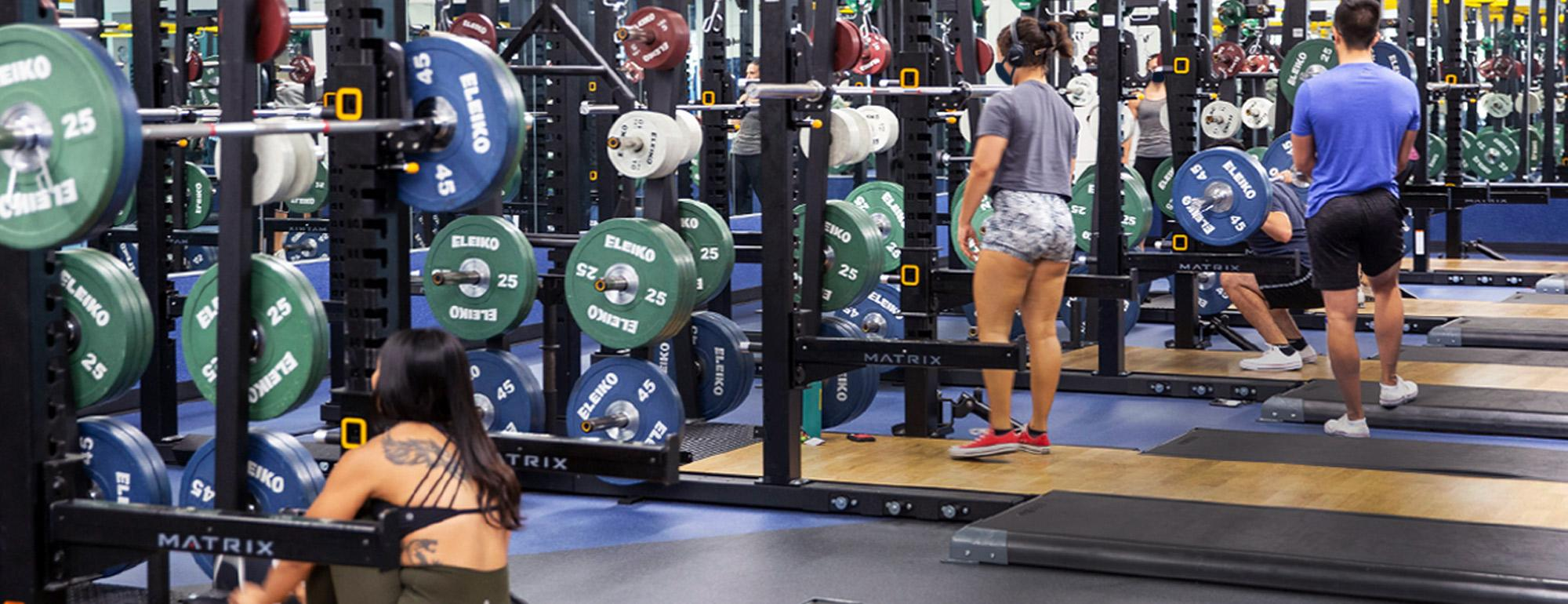 Image of students using weight lifting equipment in the ARC