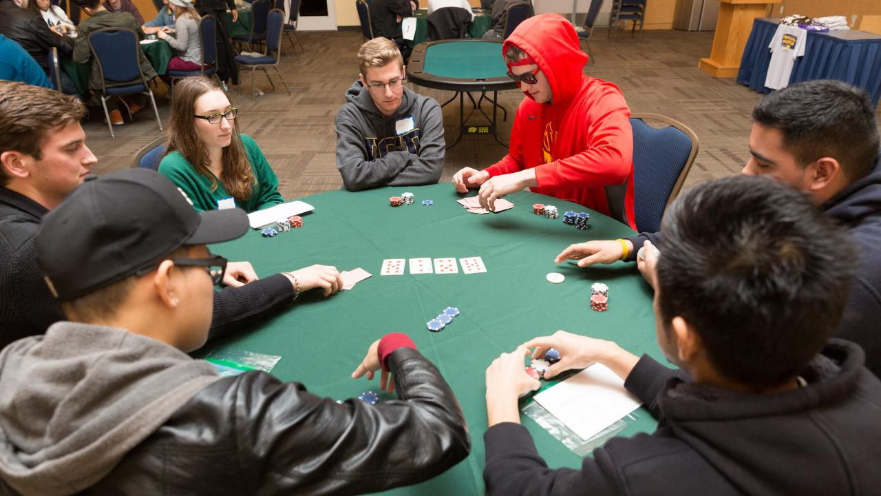 Boys and girls playing Poker