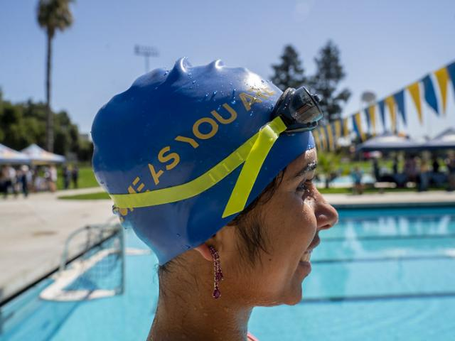 Woman in swim cap and goggles