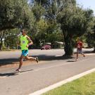 Runners racing outdoors in a 5K race