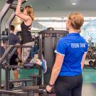 Personal trainer in lifting exercise session