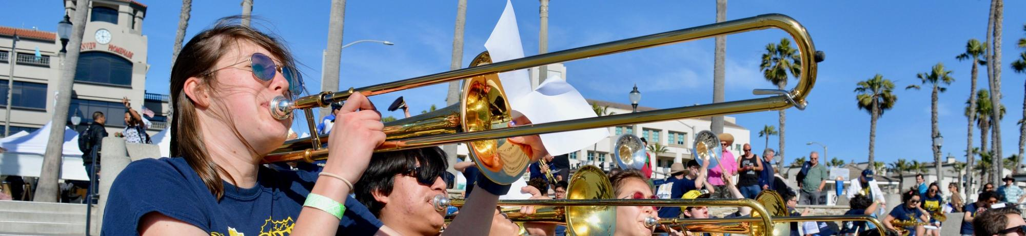 Trombone players at a beach rally in Anaheim, CA.