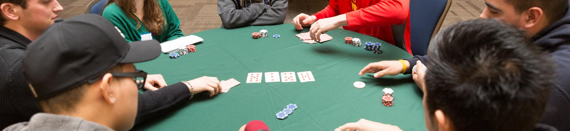Boy and Girls playing Poker together at the ARC Ballroom