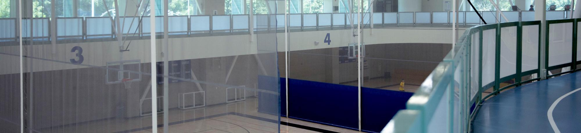 Photo of empty running track and basketball court